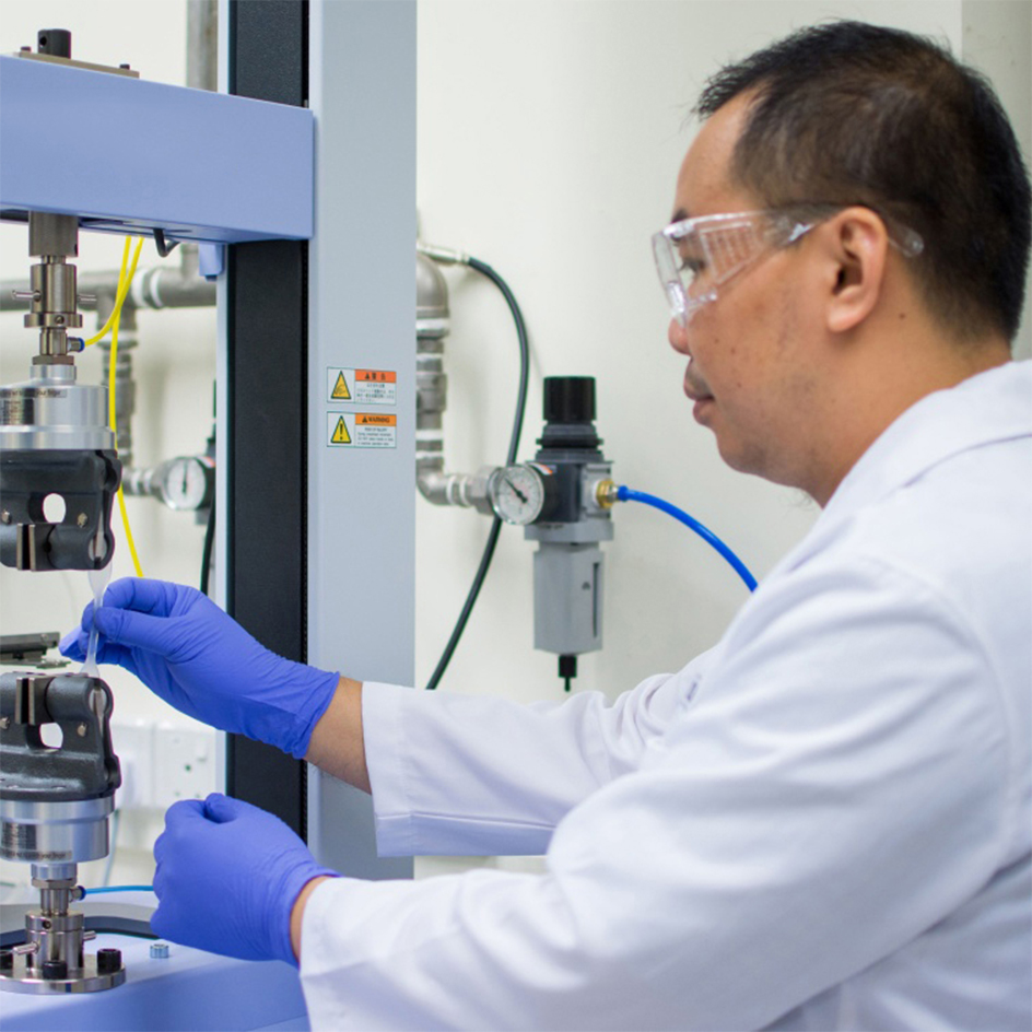 man building product in lab